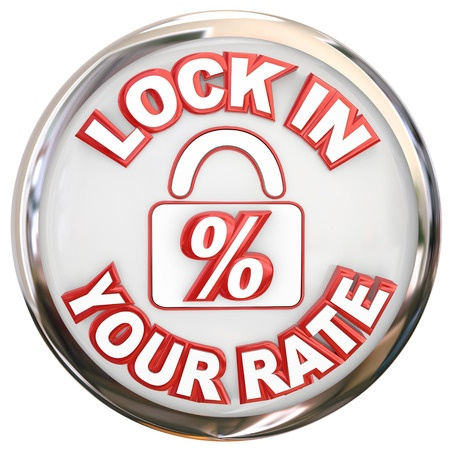 29799225 - lock in your rate words on a button or round symbol to illustrate securing a mortgage or loan number as a fixed rate on a home purchase